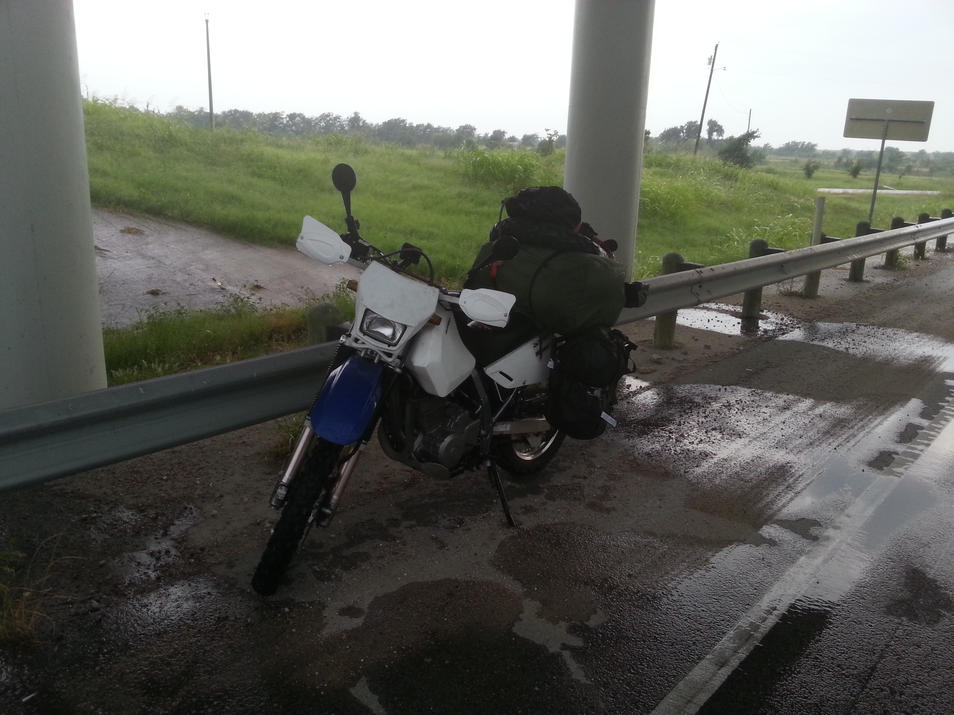 Stopped under an overpass near Midlothian, TX to put on rain gear