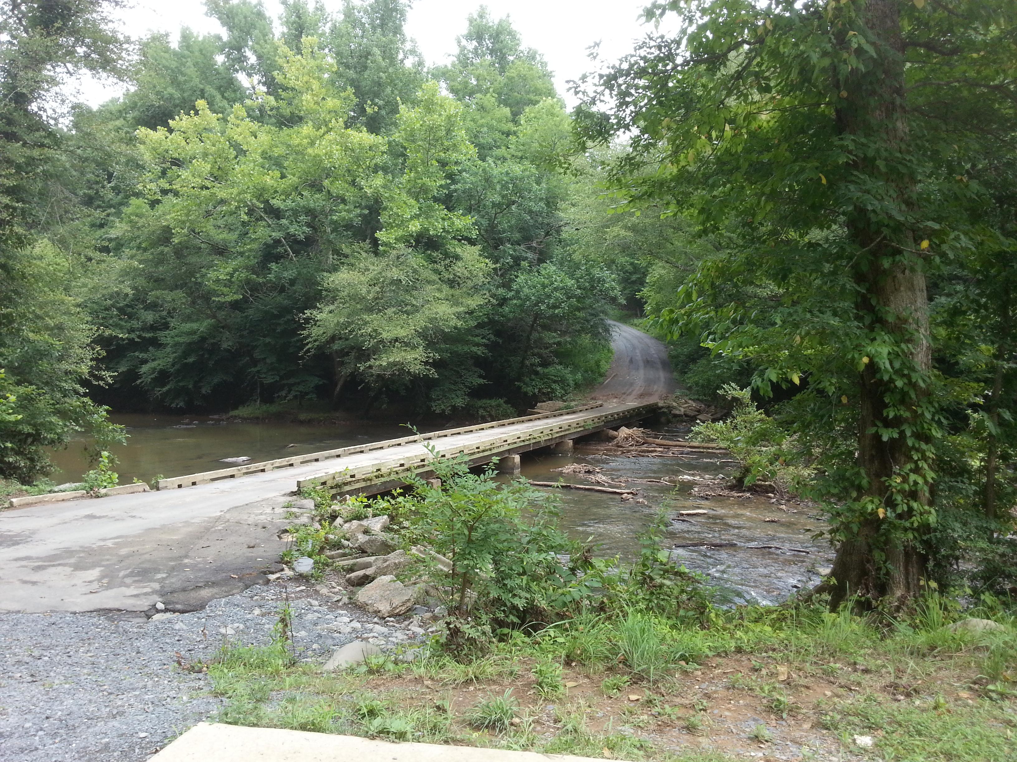 bridge in the gravel road over a creek