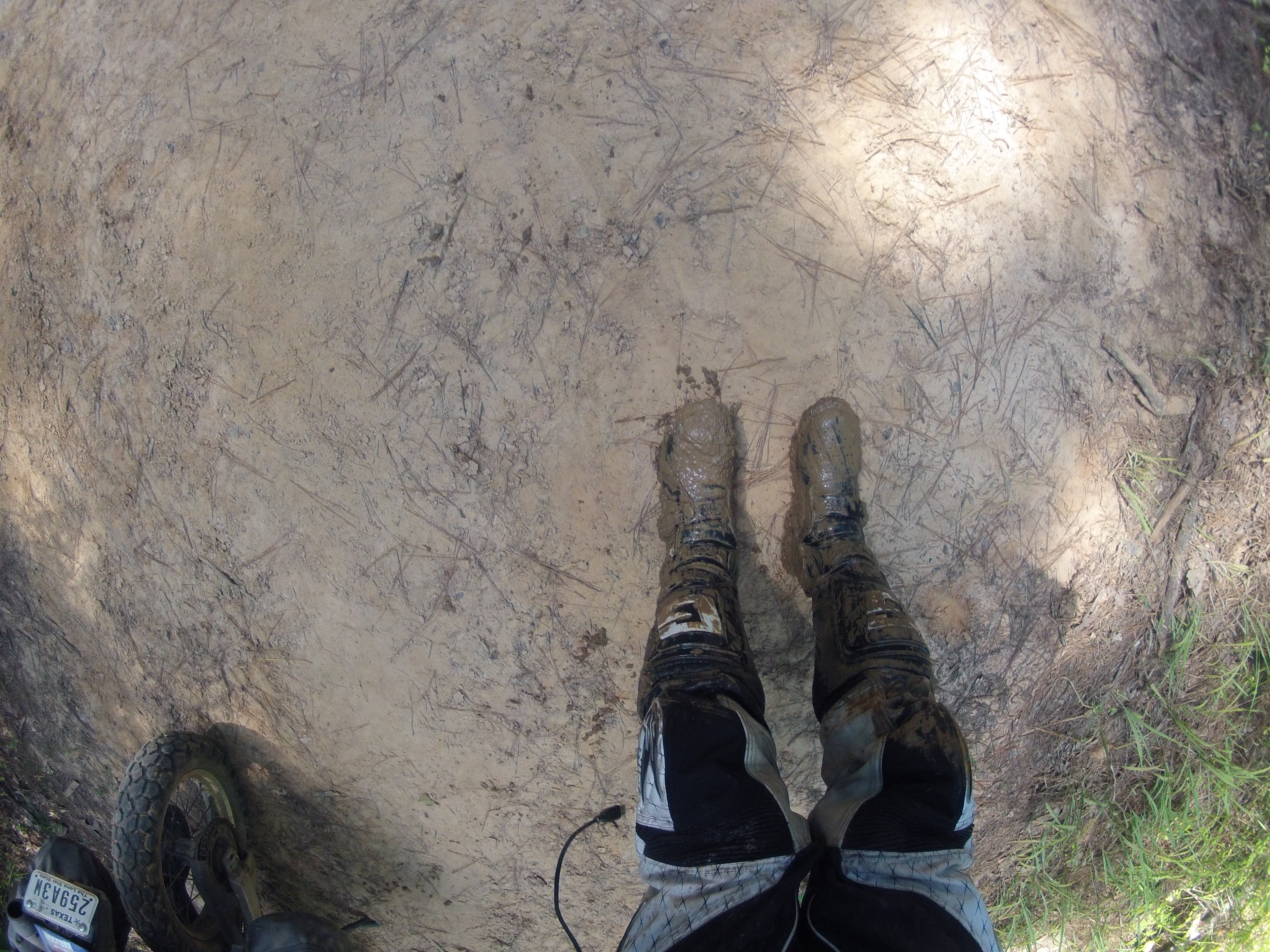 mud on my boots after falling in the mud hole