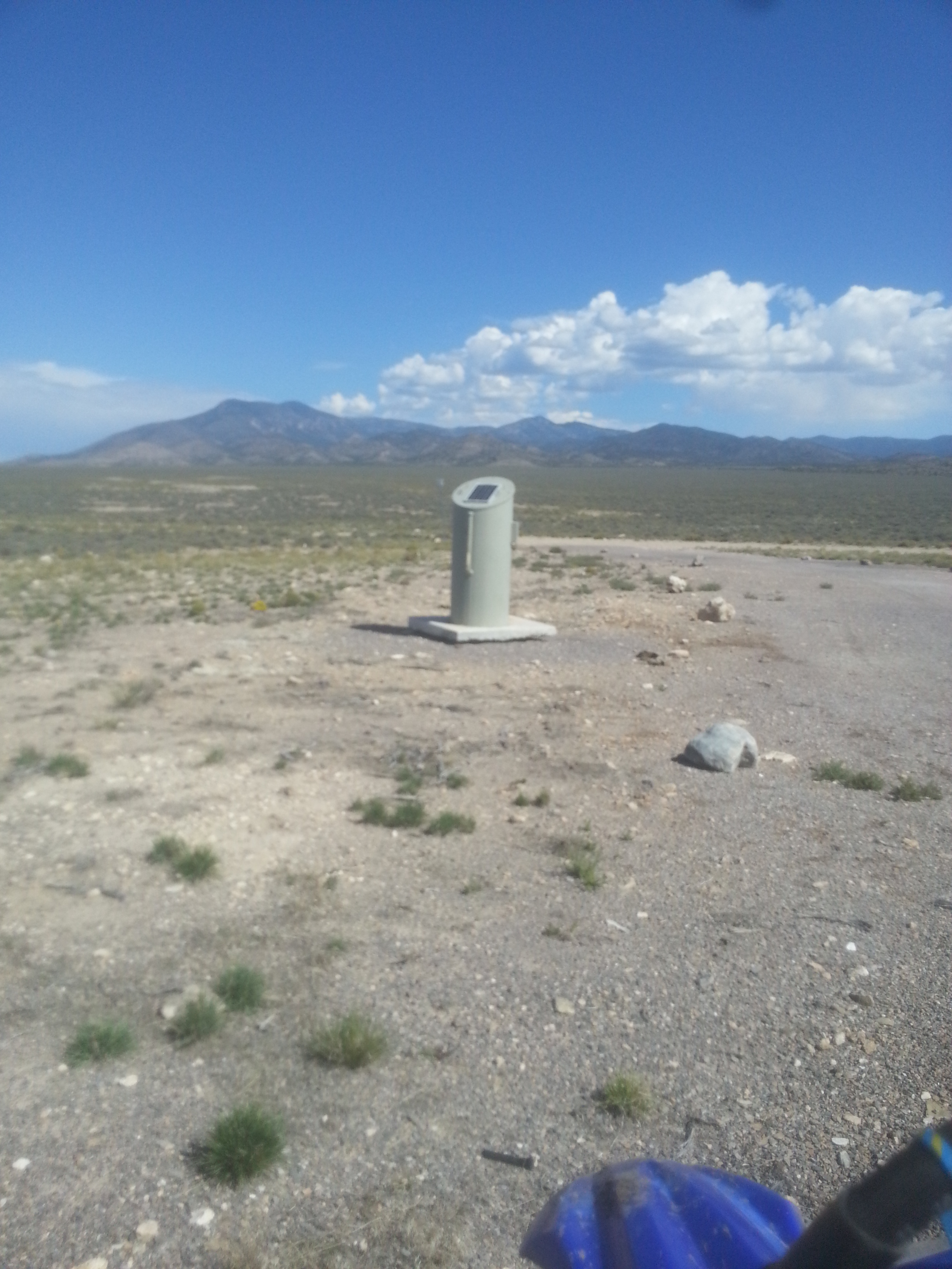 weird metal thing with a solar panel on top in the middle of nowhere, I saw a couple of these, with a sign nearby that said something about a restoration area.  Maybe a monitoring well or something?